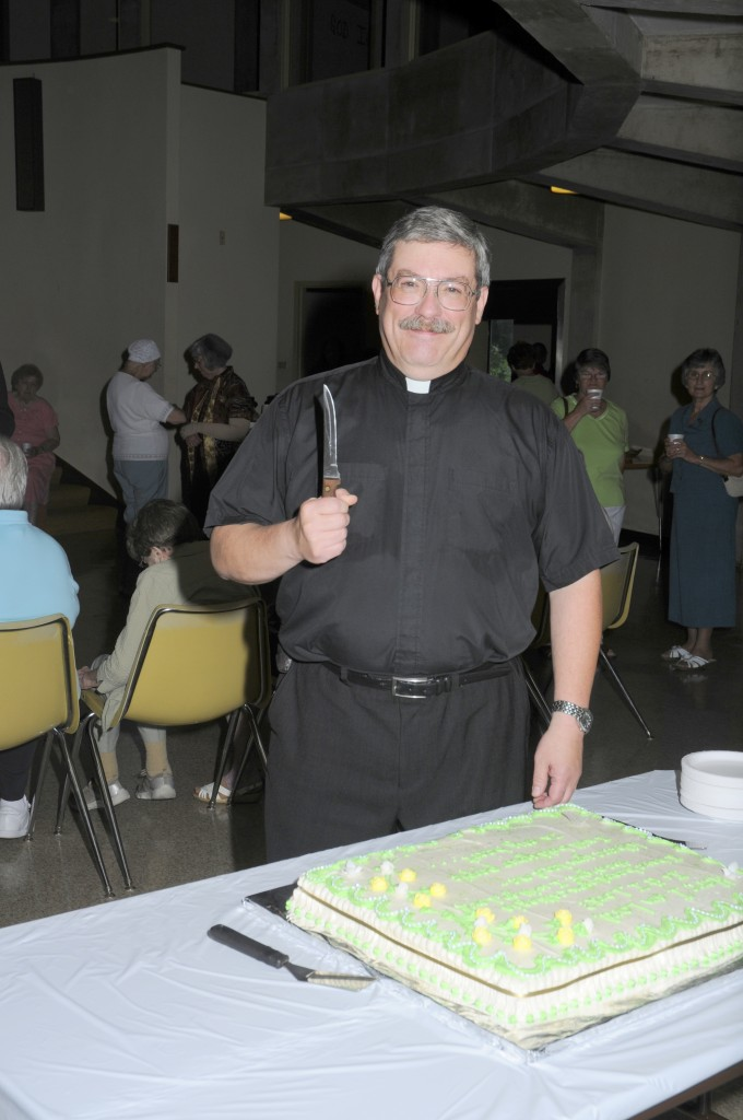 Pastor ready to cut the cake.