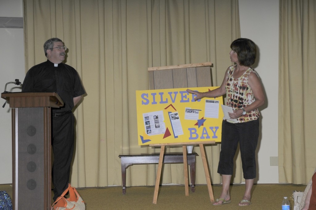 Council President Brenda Miller telling Pastor about his upcoming trip to Silver Bay