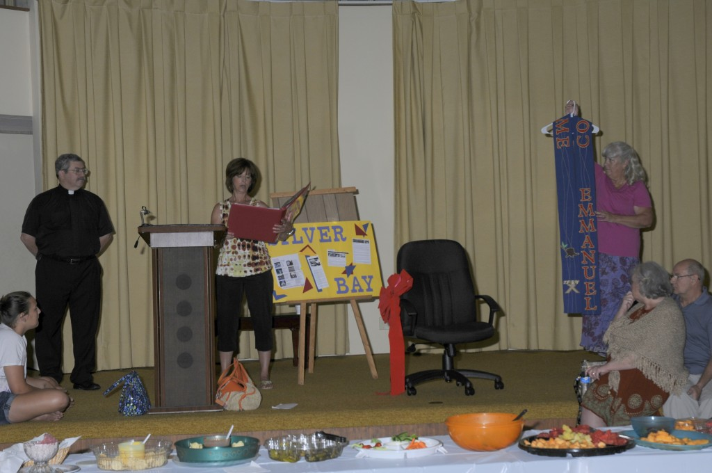 Brenda Miller reading the explanation of the symbols on Pastor Kendall's new Advent stole, made by Karen Fox